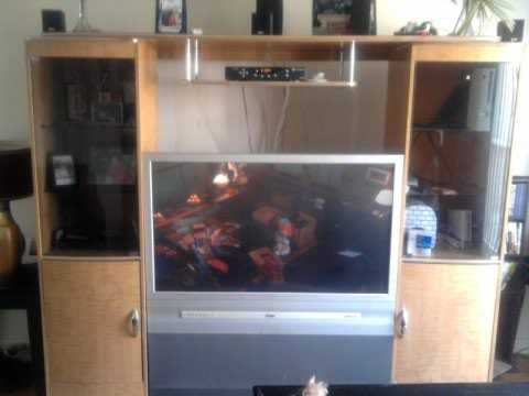 52 Inch T. V. And Entertainment Center (Must Go)