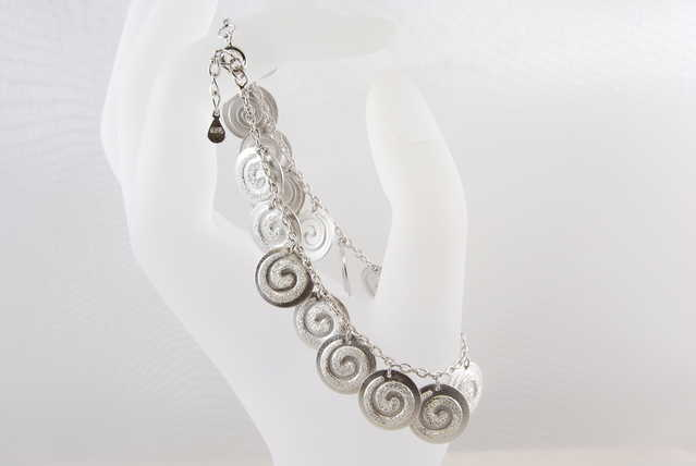 Swirl Charms High - End Rhodium Sterling Silver Bracelet - $60