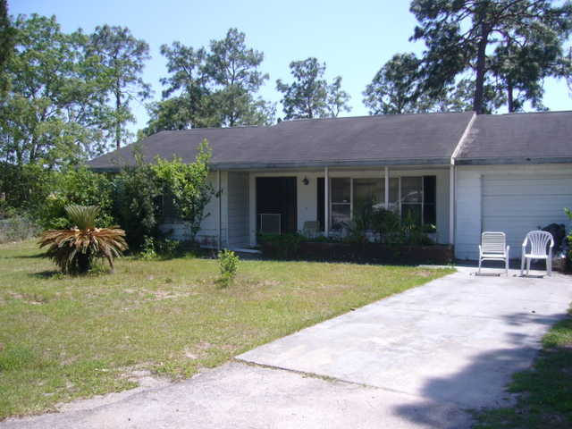Investor Opportunity!~3 / 2 House + 2 Lots In Ocala