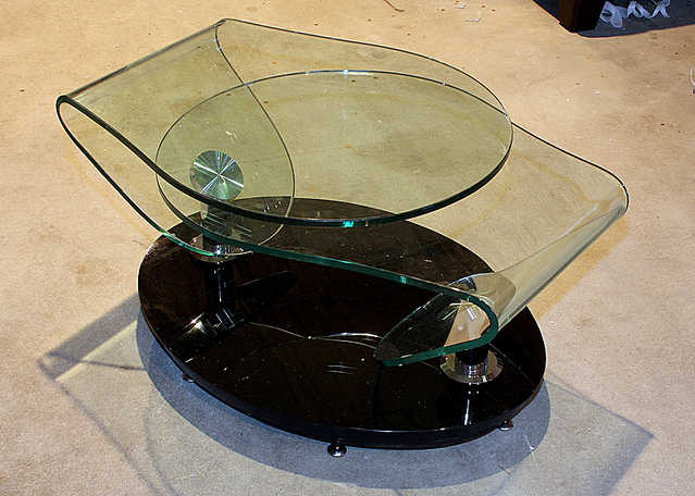 New - Revolving Shaped Glass Cocktail Table - 50% Off!