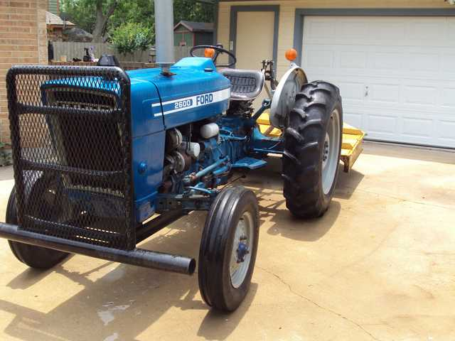 2600 Ford Tractor & 6' Brush Hog For Rent $175.00 Per Day