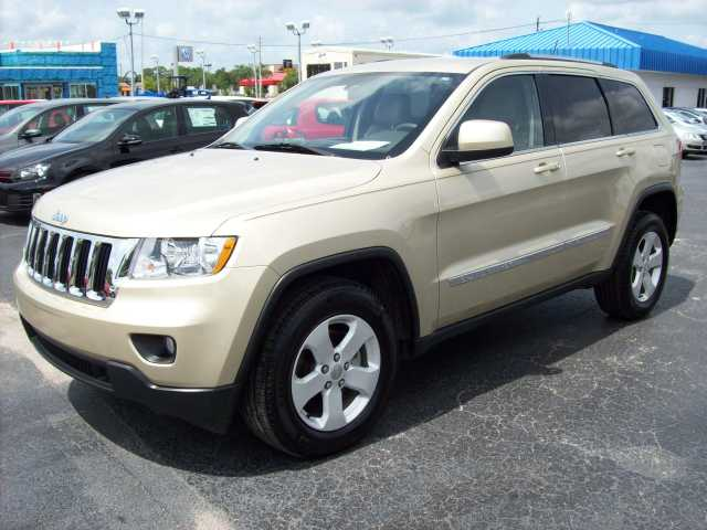 2011 Jeep Grand Cherokee Larado - Gold - 23k Mi.